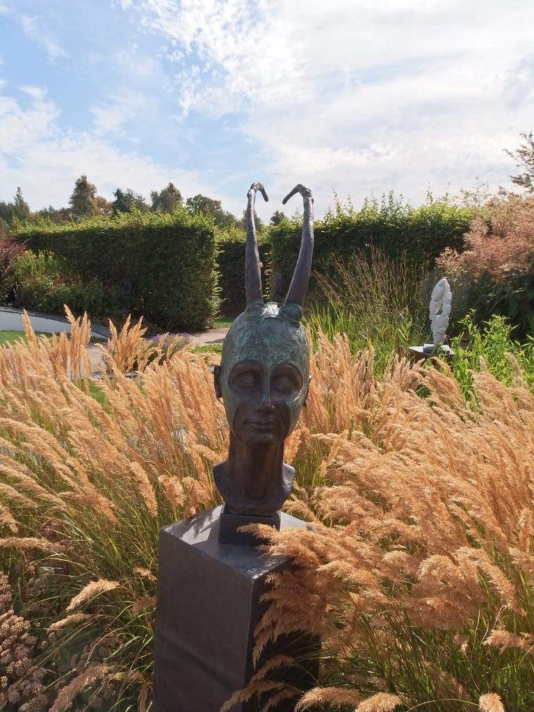 Grasses surrounding a garden sculpture