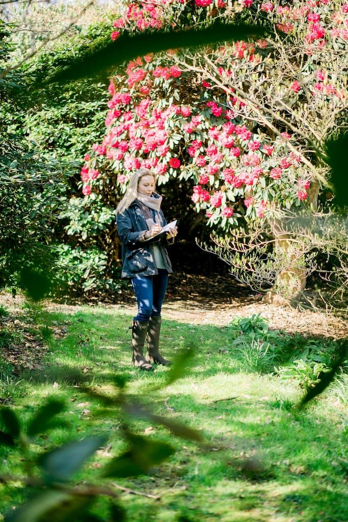 Lady surveying a garden